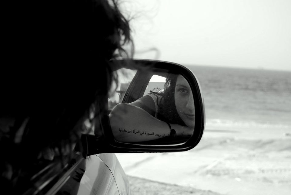 Girl Looking in Rearview Mirror - Teen Rehab