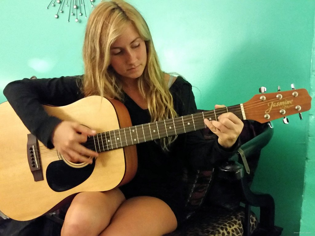 Girl Playing Guitar - Teen Rehab