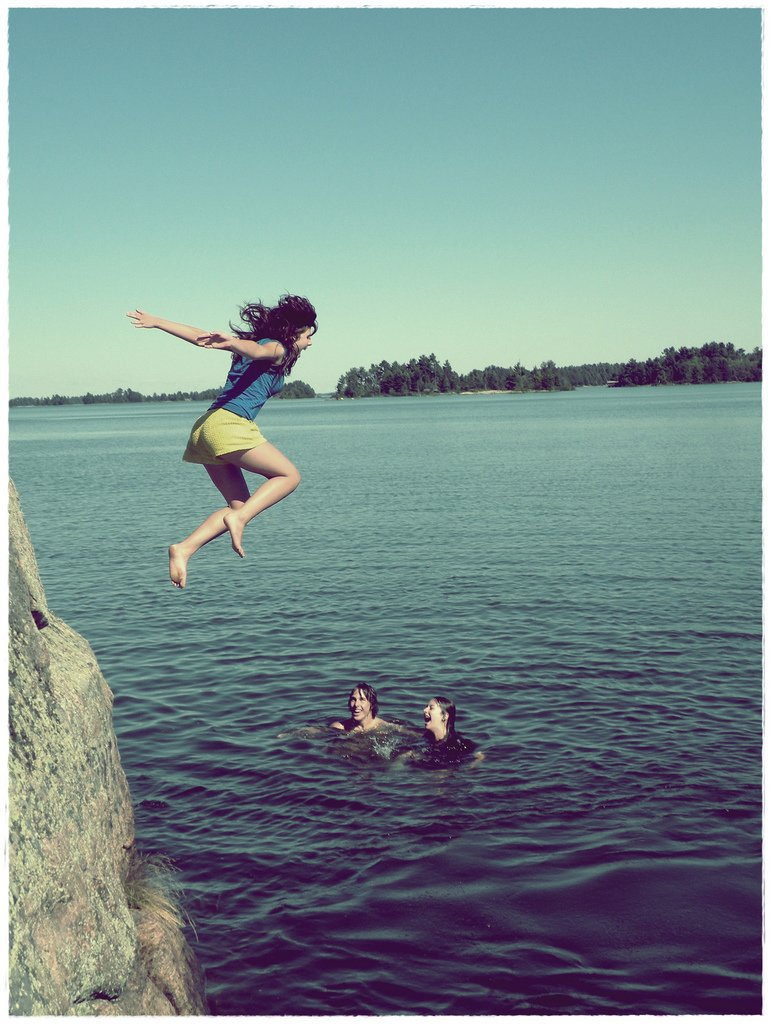 Teenage Girl Jumping Into Lake - Teen Rehab