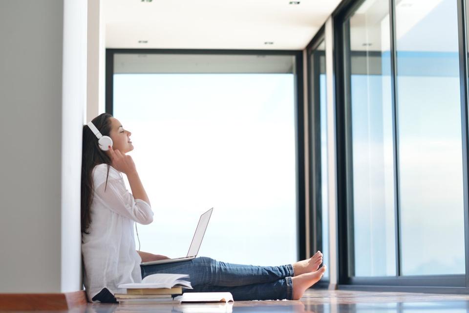 Teenage Girl Listening To Headphones - Teen Rehab