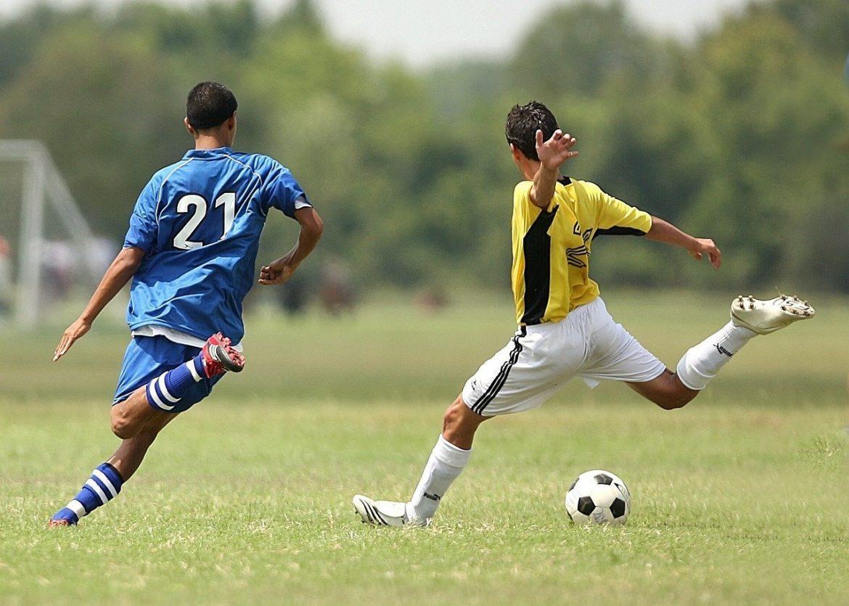 Boy Kicking Soccer Ball - Teen Rehab