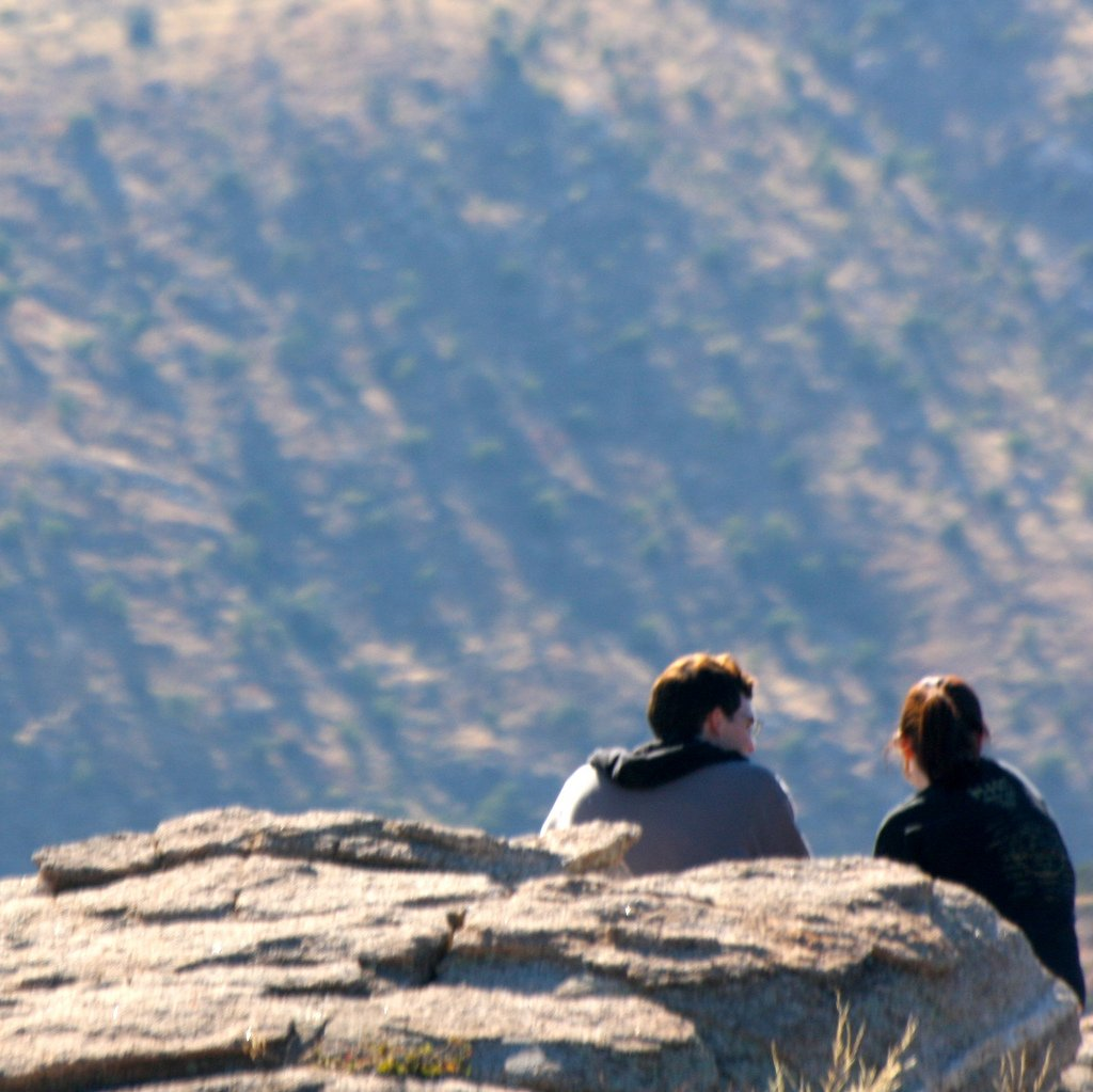 Couple Sitting on Mountainside - Teen Rehab