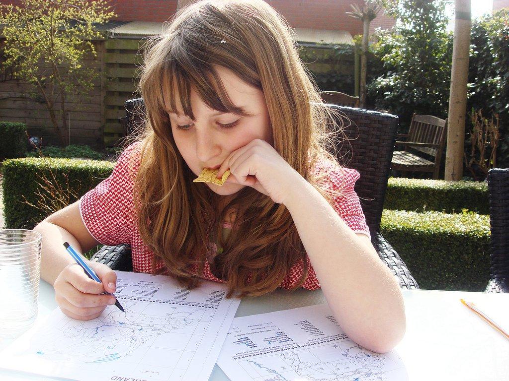 Girl Doing Homework Outside - Teen Rehab