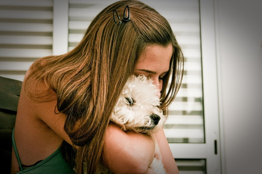 Girl Hugging Dog - Teen Rehab