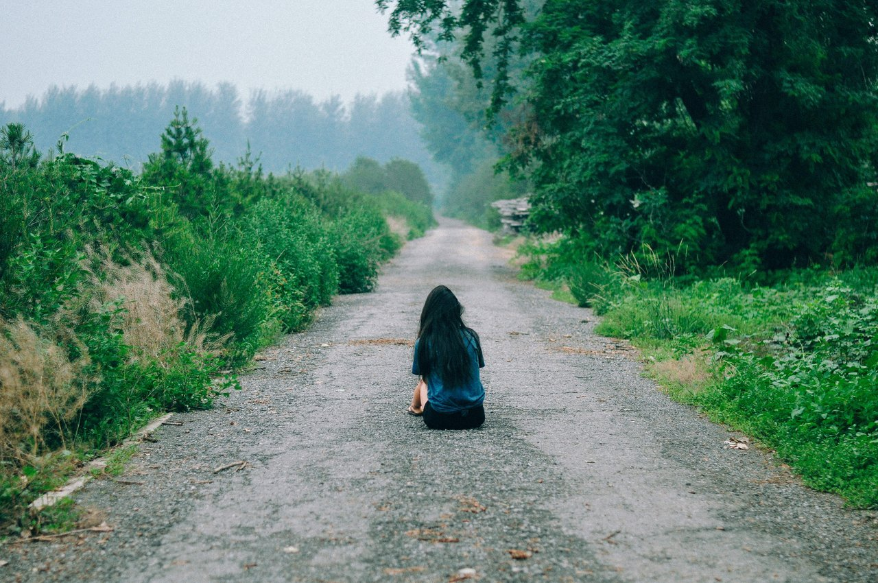 Girl Sitting on Gravel Road - Teen Rehab