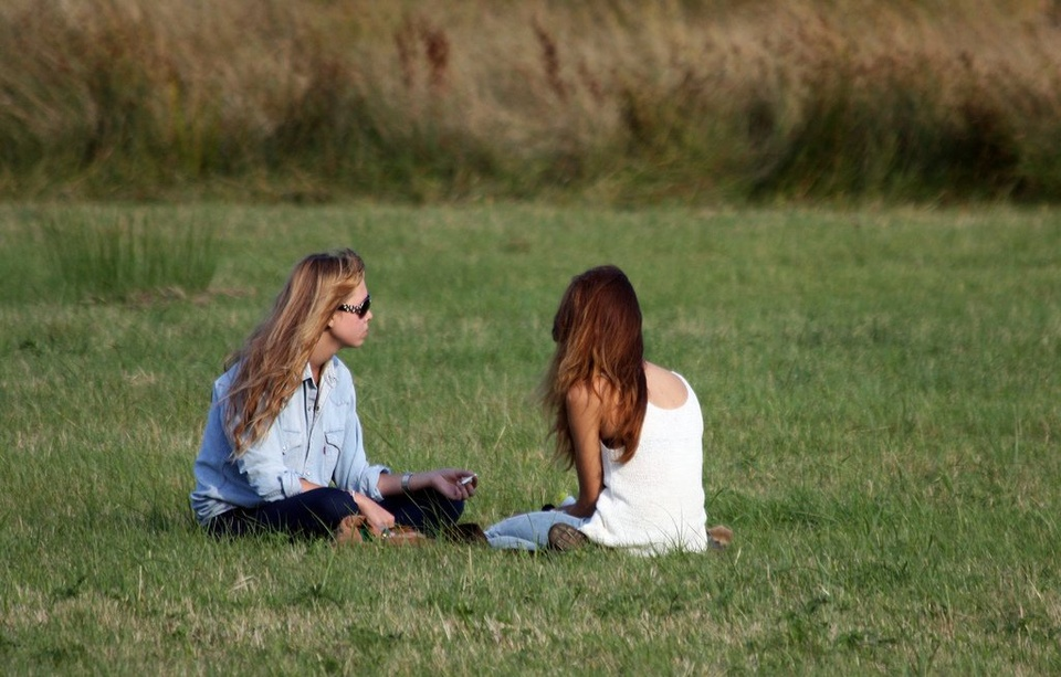 Girls Sitting In Grass Talking - Teen Rehab