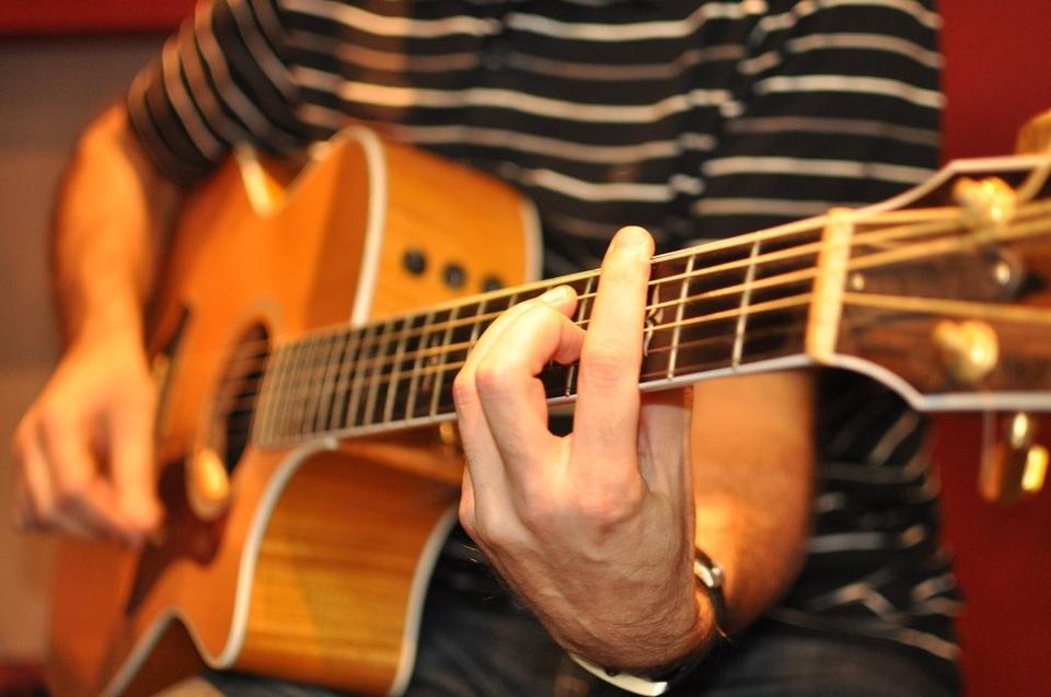 Guy Playing Guitar - Teen Rehab