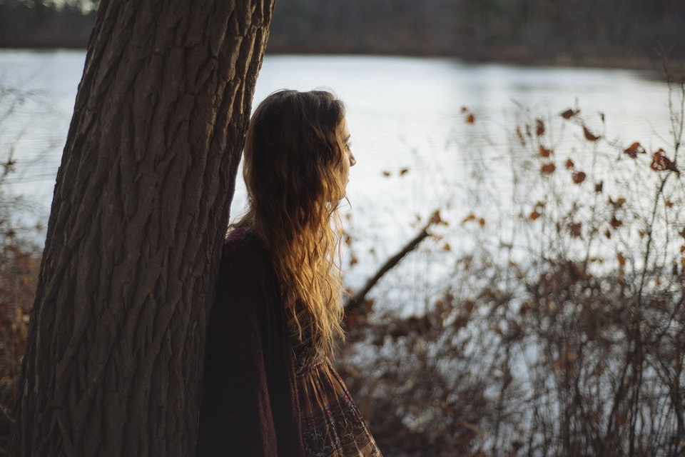 Teenage Girl Looking Out Over River - Teen Rehab
