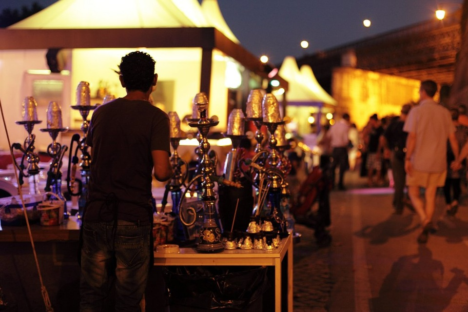 Man Standing In Front Of Table Of Hookahs - Teen Rehab