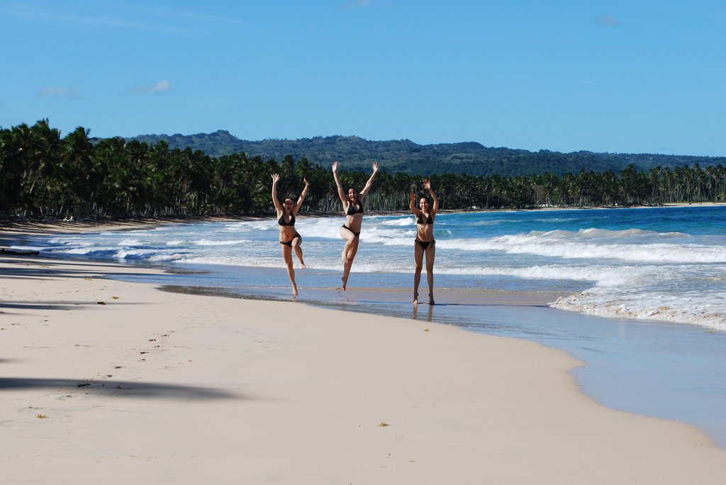 Teenage Girls Jumping On Beach - Teen Rehab