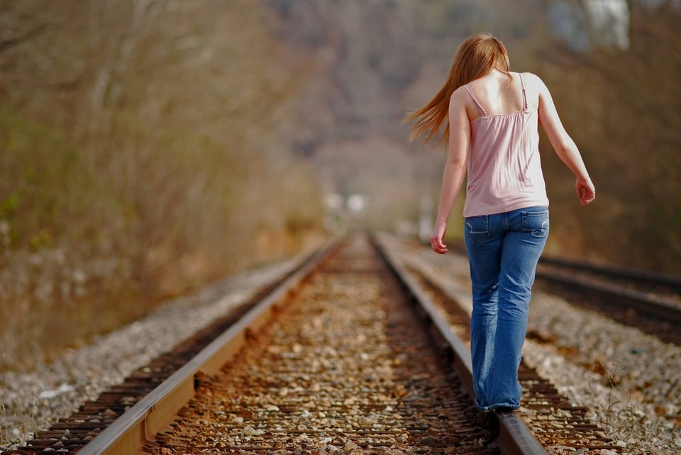 Teen Girl Balancing On Train Rails - Teen Rehab