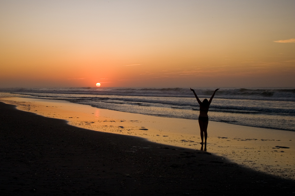 yoga pose beach ocean shore sunset