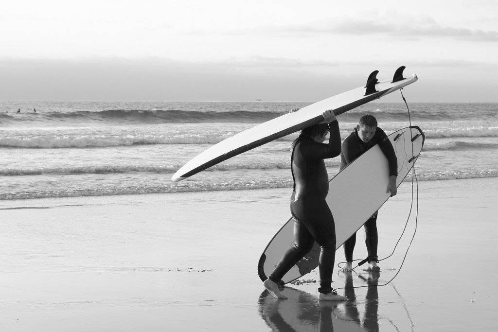 black white surfing shore beach ocean surf