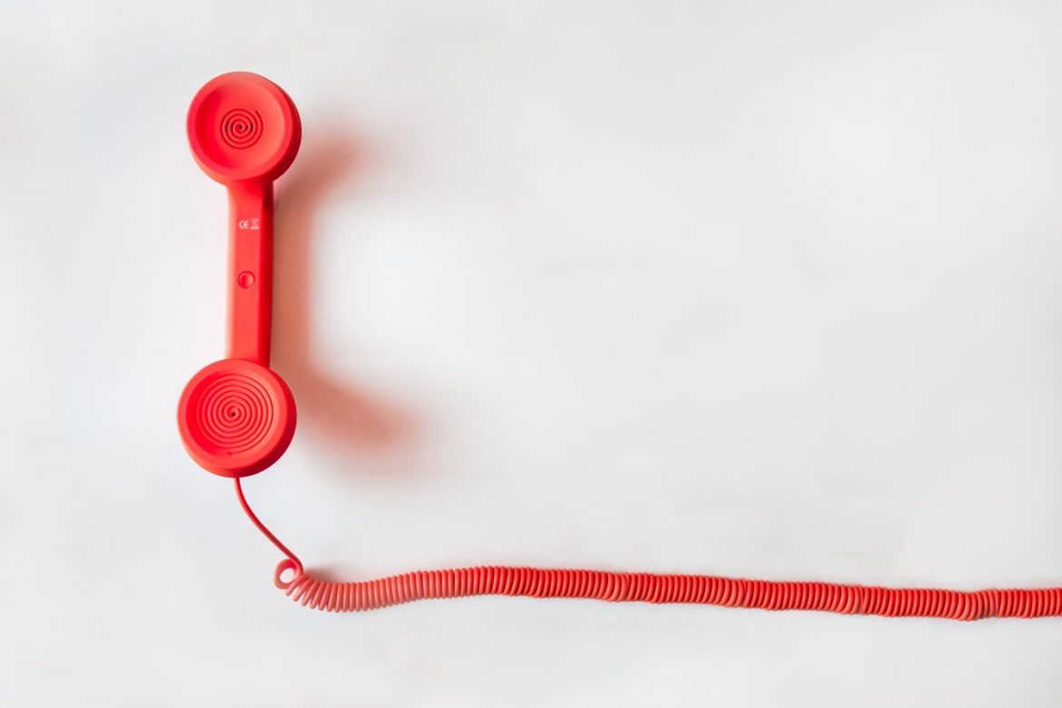 white background red telephone phone landline call