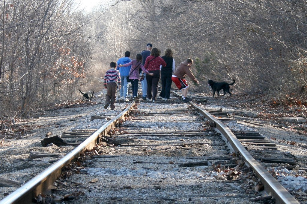 Family on a walk together on railroad tracks