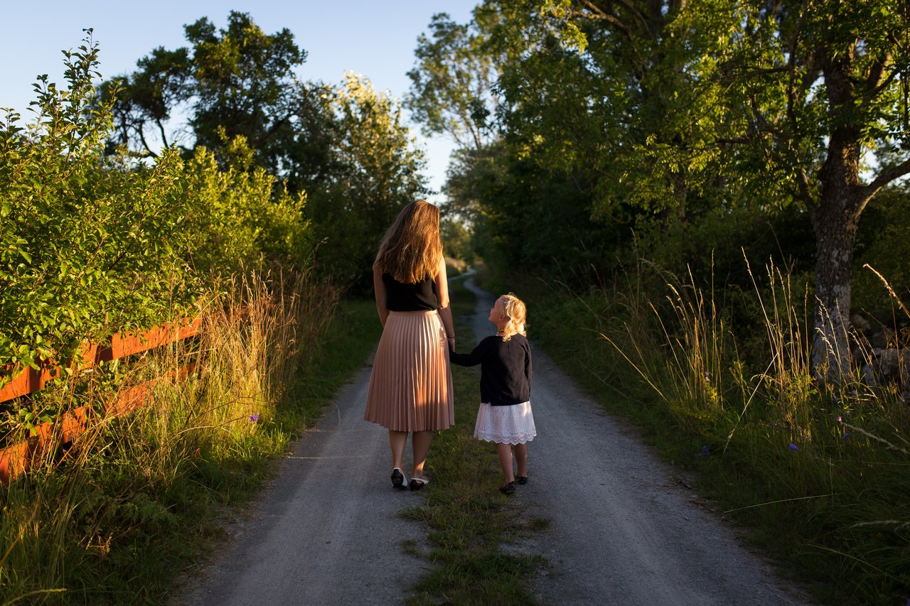 Mother walking to school with daughter