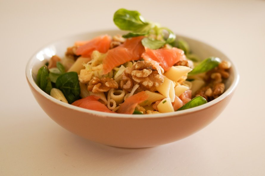 Healthy meal with vegetables, pasta, nuts