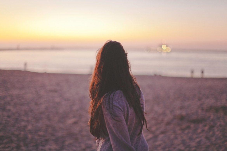 woman hair sunset beach
