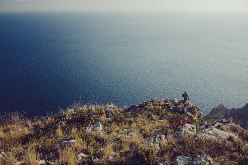 Man alone on cliffs