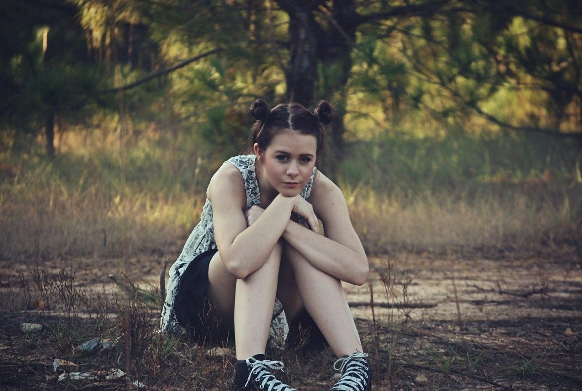 teen girl outdoors woods sitting
