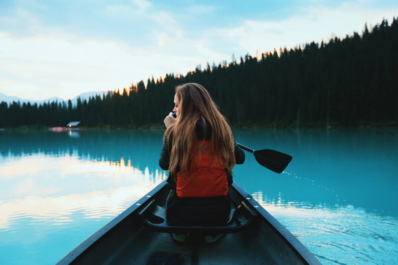 Teen navigating in canoe