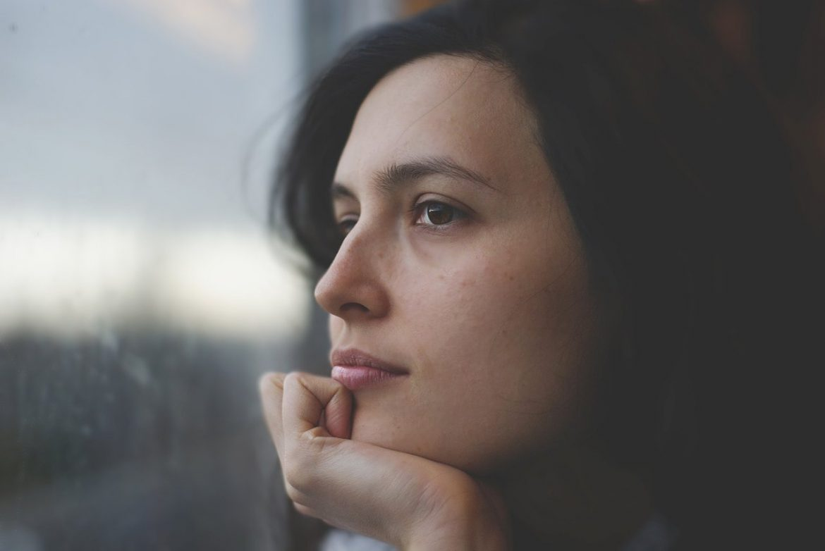 woman face pensive thinking