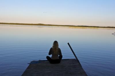 woman meditation yoga sitting water