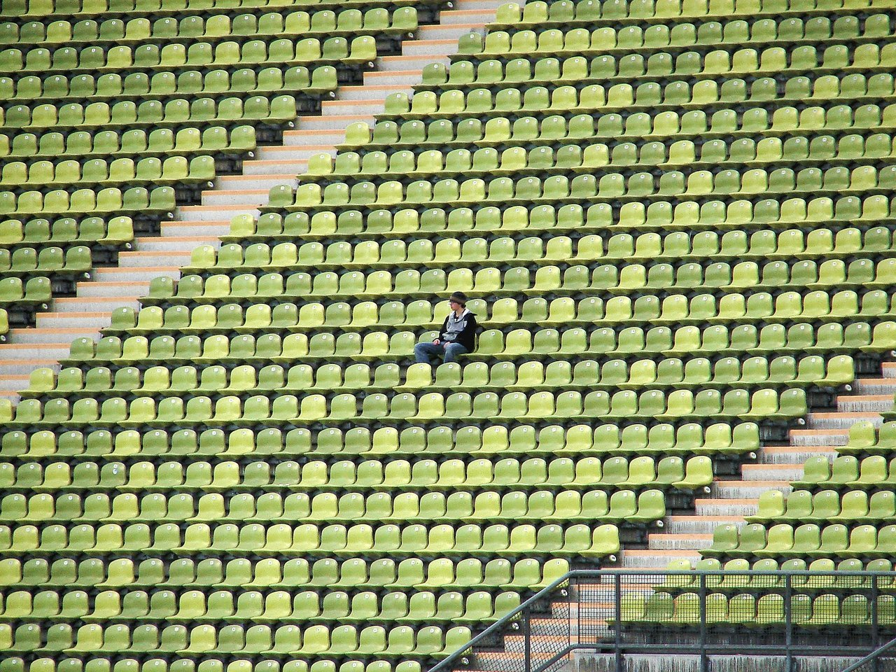 Teen sitting alone in bleachers