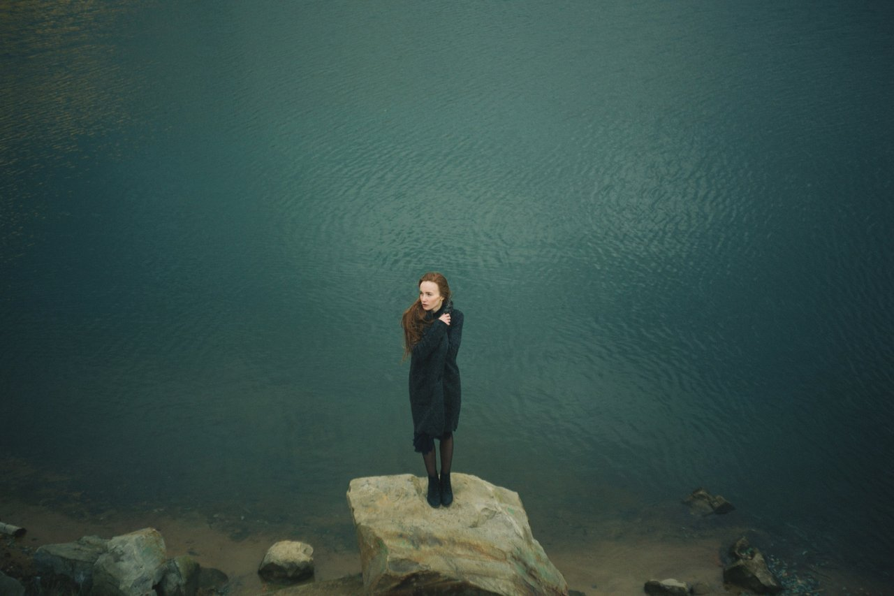 girl-standing-alone-on-rock