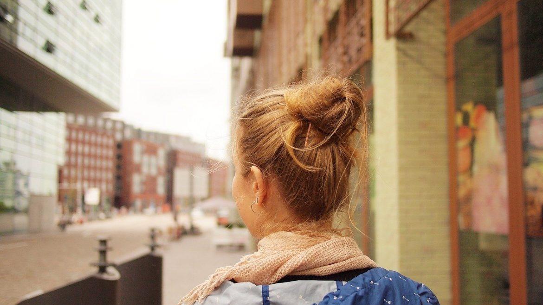 teen girl walking city street