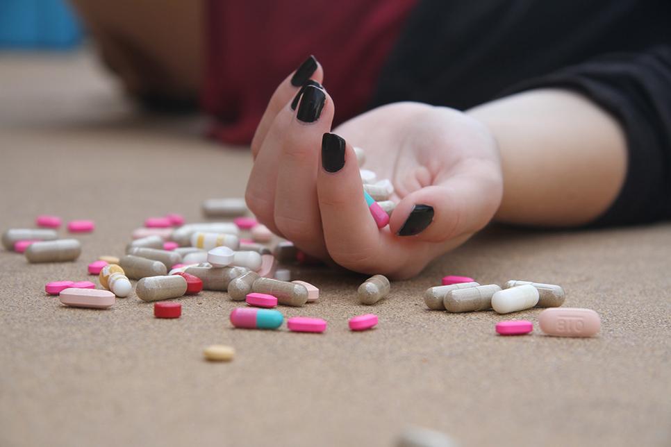 Teen Rehab - Drug Overdose - Pills In Hand