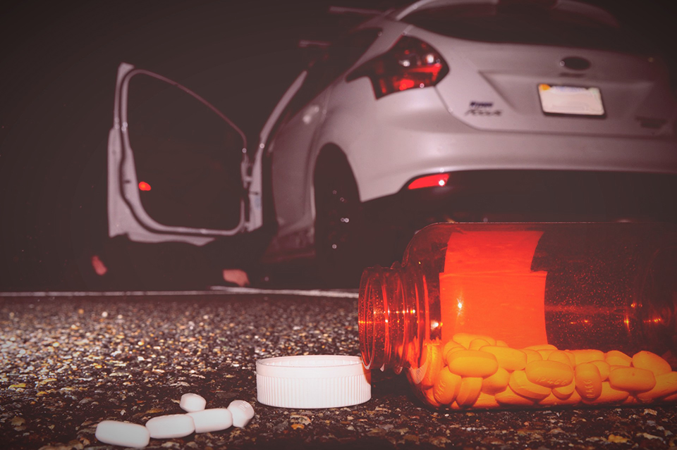 pills on ground near car